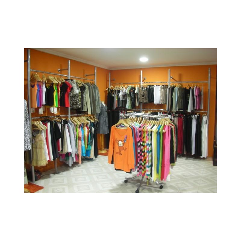 Estanterias tienda ropa for Colgadores de ropa de pared